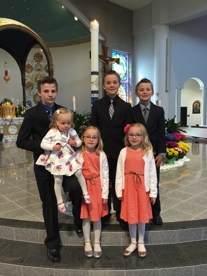 Hunter was less than thrilled when we asked him to pose for a family picture in front of lots of people after Easter Mass. We made it quick, but a certain toddler wasn't in the mood to stand still.