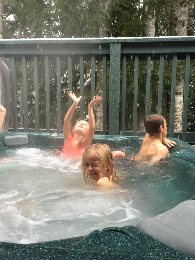 Catching snowflakes in the hot tub...